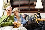 Mature couple on sofa with dog Stock Photo - Premium Royalty-Freenull, Code: 640-03255940