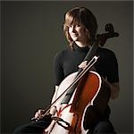 Studio portrait of young woman with cello Stock Photo - Premium Royalty-Free, Artist: Mitch Tobias, Code: 640-03256771