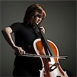 Young woman playing cello, studio shot Stock Photo - Premium Royalty-Free, Artist: Blend Images, Code: 640-03256787