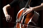 Close-up of young woman playing cello Stock Photo - Premium Royalty-Free, Artist: Robert Harding Images, Code: 640-03256789