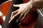 Close-up of young woman playing cello Stock Photo - Premium Royalty-Free, Artist: Mitch Tobias, Code: 640-03256791