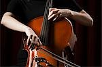 Close-up of young woman playing cello Stock Photo - Premium Royalty-Free, Artist: Mitch Tobias, Code: 640-03256792