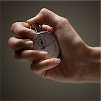 stop watch - Young woman's hand holding stop clock Stock Photo - Premium Royalty-Freenull, Code: 640-03257127