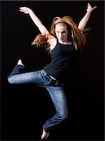 Young woman jumping, studio shot Stock Photo - Premium Royalty-Freenull, Code: 640-03257310