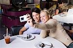 Two girl friends using a digital camera Stock Photo - Premium Royalty-Free, Artist: Dave Robertson, Code: 640-03259443