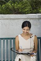 planner - Woman working sitting on bench Stock Photo - Premium Royalty-Freenull, Code: 640-03259504
