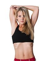 female rear end - Woman from behind stretching arms Stock Photo - Premium Royalty-Freenull, Code: 640-03259555