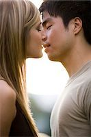 Young couple about to kiss Stock Photo - Premium Royalty-Freenull, Code: 640-03259852