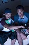 Two teenage boys eating snacks Stock Photo - Premium Royalty-Free, Artist: Push Pictures, Code: 640-03260022