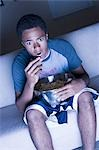Teenage boy eating popcorn Stock Photo - Premium Royalty-Free, Artist: Push Pictures, Code: 640-03260028