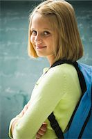 preteen  smile  one  alone - Girl in classroom Stock Photo - Premium Royalty-Freenull, Code: 640-03260526