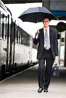 Closeup of man with umbrella Stock Photo - Premium Royalty-Freenull, Code: 640-03260797