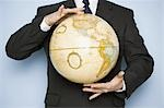 Man holding globe Stock Photo - Premium Royalty-Free, Artist: Beyond Fotomedia, Code: 640-03260821