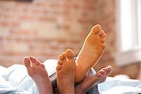 Four feet under blankets Stock Photo - Premium Royalty-Freenull, Code: 640-03261476