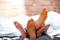Four feet under blankets Stock Photo - Premium Royalty-Freenull, Code: 640-03261477
