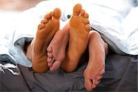 Four feet under blankets Stock Photo - Premium Royalty-Freenull, Code: 640-03261478