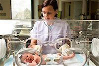 Nurse examining newborn in incubator Stock Photo - Premium Royalty-Freenull, Code: 640-03261664