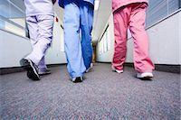 Nurses walking and talking Stock Photo - Premium Royalty-Freenull, Code: 640-03261693