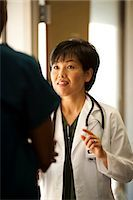 Male and female doctors talking Stock Photo - Premium Royalty-Freenull, Code: 640-03261730