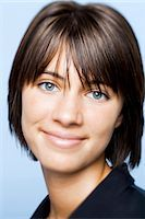 Closeup of woman with green eyes smiling Stock Photo - Premium Royalty-Freenull, Code: 640-03262029