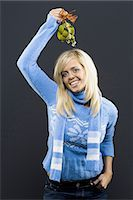 Woman holding mistletoe Stock Photo - Premium Royalty-Freenull, Code: 640-03262419