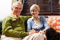 Mature couple cuddling on sofa Stock Photo - Premium Royalty-Freenull, Code: 640-03262861