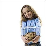 Young girl holding cookie jar Stock Photo - Premium Royalty-Freenull, Code: 640-03265225