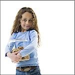 Young girl holding cookie jar Stock Photo - Premium Royalty-Freenull, Code: 640-03265226