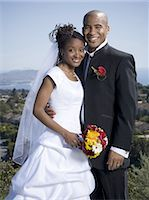Portrait of a newlywed couple smiling together Stock Photo - Premium Royalty-Freenull, Code: 640-03265670