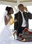 Bride and groom eating their wedding cake Stock Photo - Premium Royalty-Freenull, Code: 640-03265694