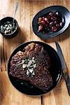 T-bone Steak Topped With Cheese and Herbs and Served With Shallots Stock Photo - Premium Rights-Managed, Artist: Angus Fergusson, Code: 700-03265813