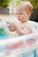Baby Girl in Inflatable Pool Stock Photo - Premium Royalty-Freenull, Code: 600-03284220