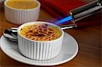 Creme Brulee being flamed Stock Photo - Premium Rights-Managed, Artist: foodanddrinkphotos, Code: 824-03285422