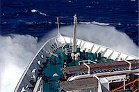 sailing boat storm - Antarctica,Antarctic Peninsula,Drakes Passage. Running into heavy seas,the bow of the expedition ship MV Discovery cut a path through the deep blue sea separating the southern continent from South America. Stock Photo - Premium Rights-Managednull, Code: 862-03288511