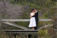 A couple in formal dress in the bush settings of the Kingfisher Bay Resort on Fraser Island. Stock Photo - Premium Rights-Managednull, Code: 862-03288755