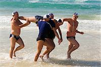 Lifesavers practice a surf rescue on Bondi Beach using the traditional belt,line and reel methond Stock Photo - Premium Rights-Managednull, Code: 862-03288864