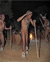 Bushmen,or San,dance during a sing-song round their campfire. The men have rattles wound round their legs to help the rest of them keep rhythm during their dances.These NS hunter gatherers live in the Xai Xai Hills close to the Namibian border. Their traditional way of life is fast disappearing. Stock Photo - Premium Rights-Managednull, Code: 862-03289592