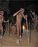 Bushmen,or San,dance during a sing-song round their campfire. The men have rattles wound round their legs to help the rest of them keep rhythm during their dances.These NS hunter gatherers live in the Xai Xai Hills close to the Namibian border. Their traditional way of life is fast disappearing. Stock Photo - Premium Rights-Managed, Artist: AWL Images, Code: 862-03289592