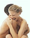 Close-up of Nude Couple, Woman Biting Man's Shoulder Stock Photo - Premium Rights-Managed, Artist: Harald Vorsteher, Code: 700-03290109