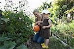 Mother and Daughter in Garden Watering Plants, Vancouver, British Columbia, Canada Stock Photo - Premium Royalty-Free, Artist: Sarah Murray, Code: 600-03290329