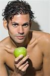 Portrait of Man holding Apple Stock Photo - Premium Rights-Managed, Artist: Marcus Mok, Code: 700-03290308