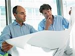 Architects looking at blue prints Stock Photo - Premium Royalty-Freenull, Code: 649-03292182