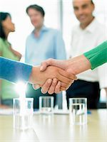 Closing a business deal by shaking hands Stock Photo - Premium Royalty-Freenull, Code: 649-03292187