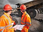 Workers Inspecting Trucks In Coal Mine Stock Photo - Premium Royalty-Freenull, Code: 649-03294031