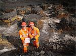 Workers With Clipboard In Coal Mine Stock Photo - Premium Royalty-Freenull, Code: 649-03294042