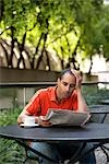 Man Looking Upset While Reading the Newspaper Stock Photo - Premium Rights-Managed, Artist: Melissa Barnes, Code: 700-03294845