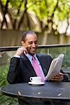 Businessman Reading the Newspaper Stock Photo - Premium Rights-Managed, Artist: Melissa Barnes, Code: 700-03294846