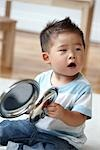 Baby Boy Playing with Pots and Pans Stock Photo - Premium Rights-Managed, Artist: Mark Burstyn, Code: 700-03294885