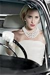 Portrait of Glamourous Woman Driving a 1964 Chevrolet Imperial LeBaron Stock Photo - Premium Rights-Managed, Artist: Michael Mahovlich, Code: 700-03295276