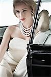 Portrait of Glamourous Woman in a 1964 Chevrolet Imperial LeBaron Stock Photo - Premium Rights-Managed, Artist: Michael Mahovlich, Code: 700-03295278